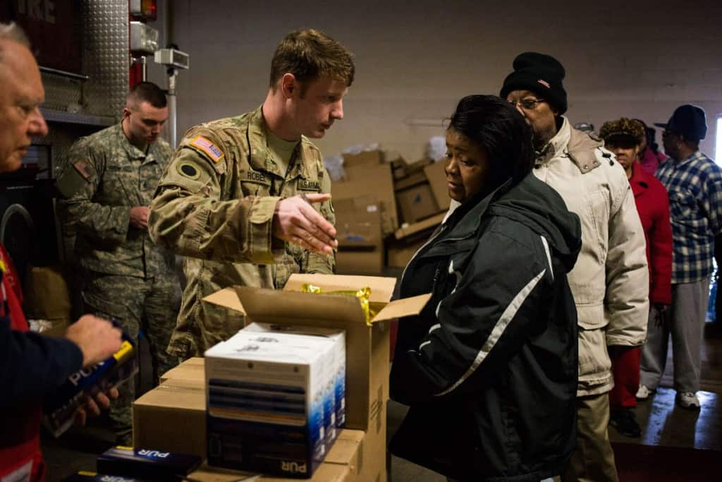 The National Guard has arrived in Flint, Michigan, passing out bottled water and filters in an effort to protect residents from the city's tainted water supply. CREDIT PHOTOGRAPH BY BRITTANY GREESON / THE NEW YORK TIMES / REDUX
